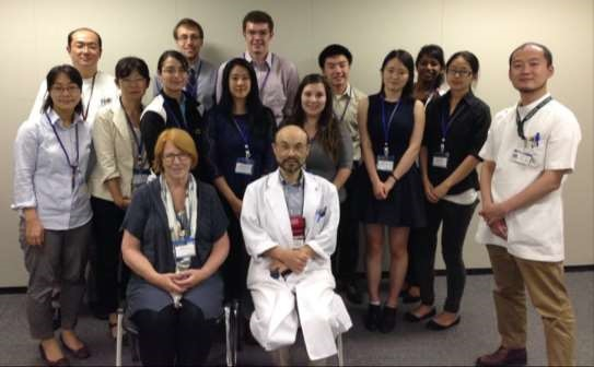 Prof. Pat Lambert (seated at front) and JCMUstudents meet with medical professionals during the HCJ 2015 program.